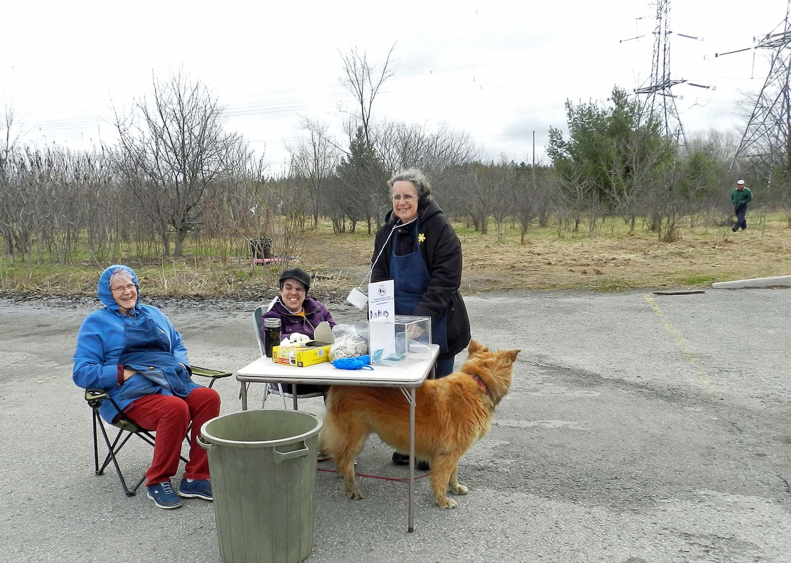 Dagmar VanBeselaere, Jennifer Harris and Julie More from Responsible Dog Owners of Canada hand out gloves, bags and dog biscuits near Shea Woods.