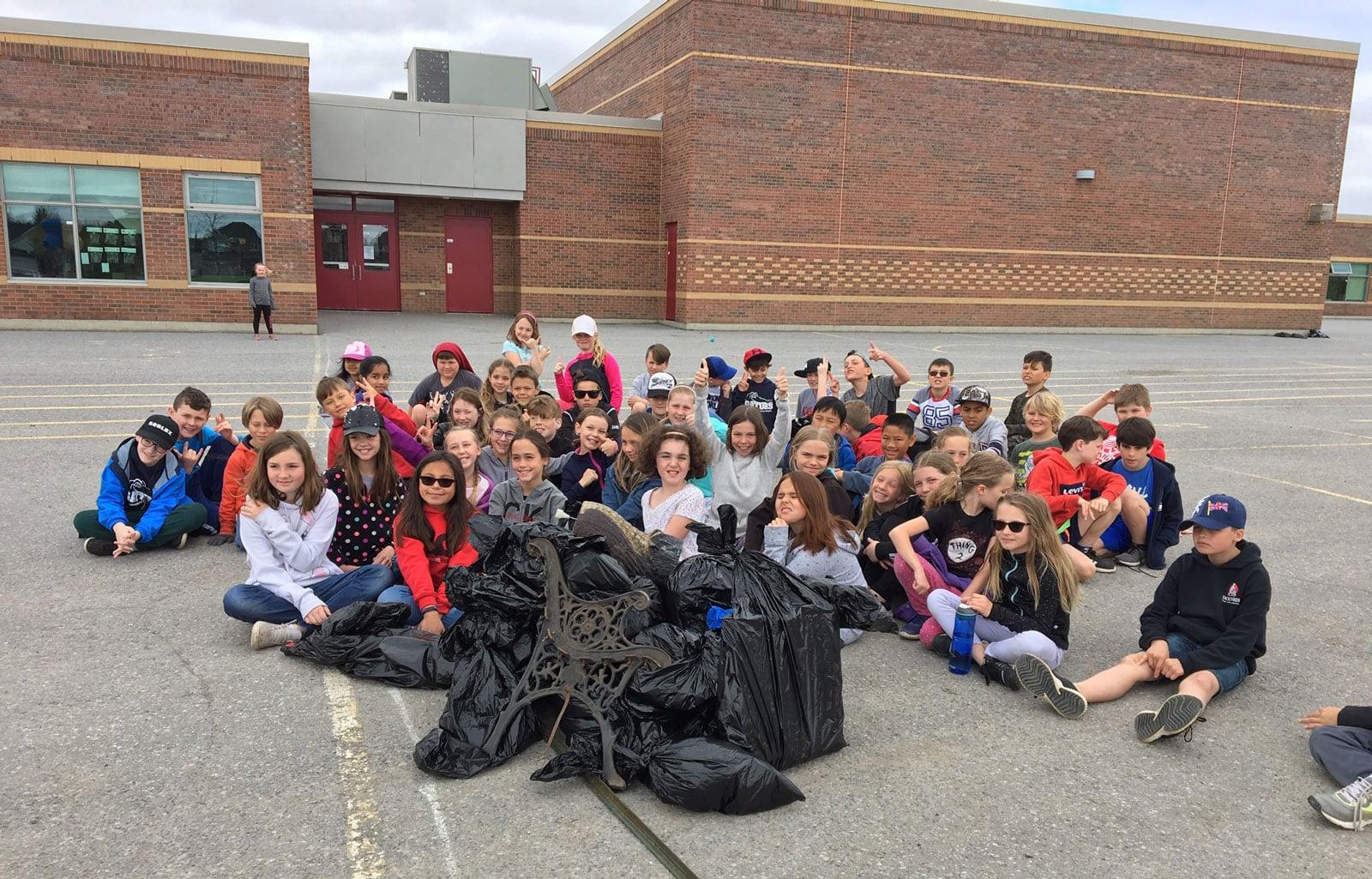 Mme. Barakat's class cleans up the neighbourhood near Guardian Angels School.