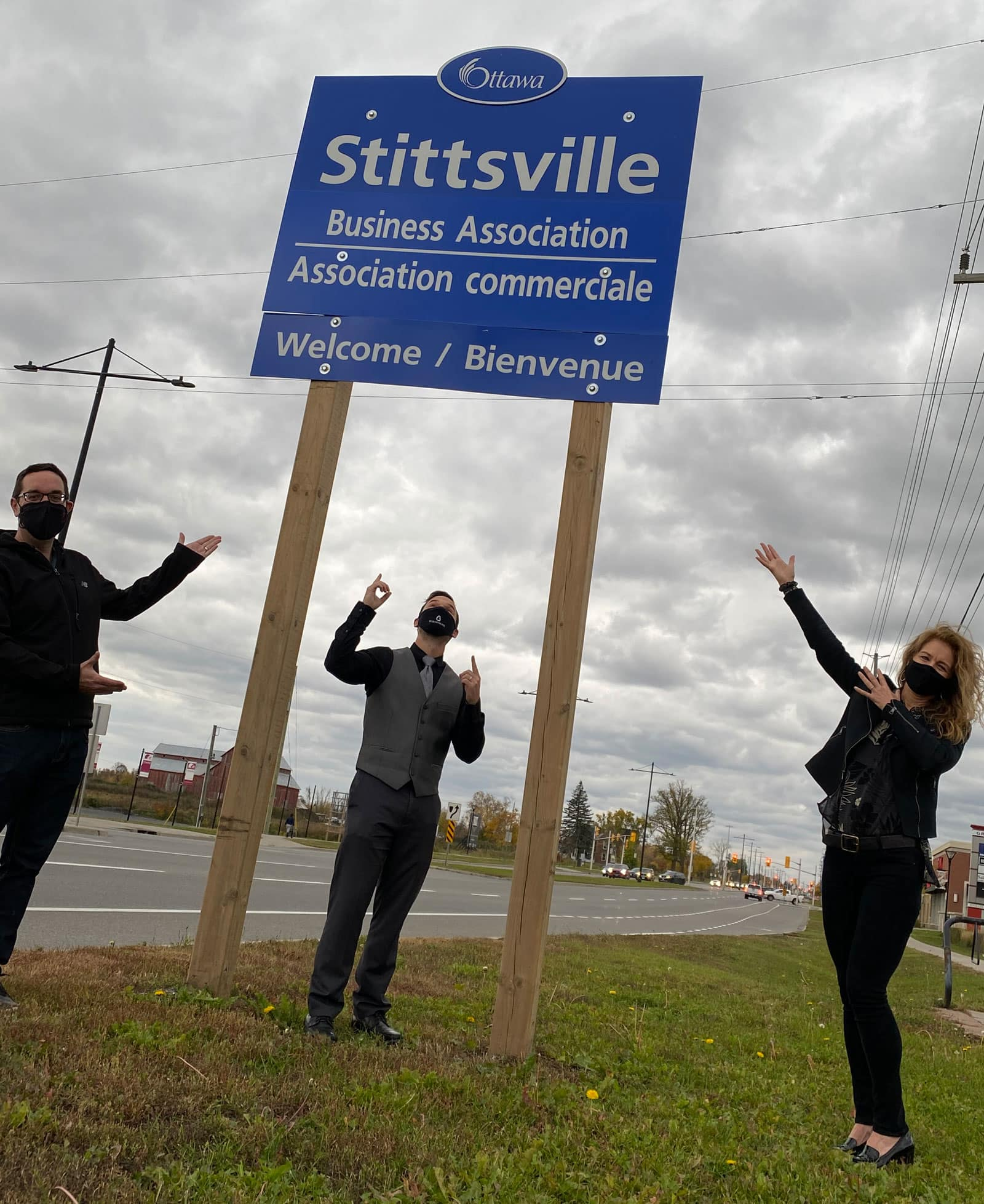 Councillor Glen Gower, Wesley Smith and Andrea Greenhaus in front of the Stittsville Business Association sign